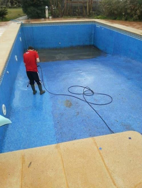 Pressure washing a pool
