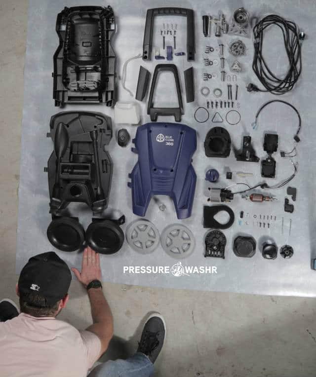 Disassembled AR Pressure Cleaner Showing Person Arrange Parts